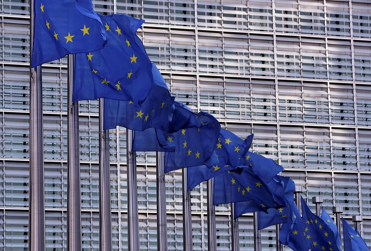 European Union flags fly outside the European Commission headquarters in Brussels, Belgium.  The EU is planning on asking India to support its global treaty against plastic pollution.
