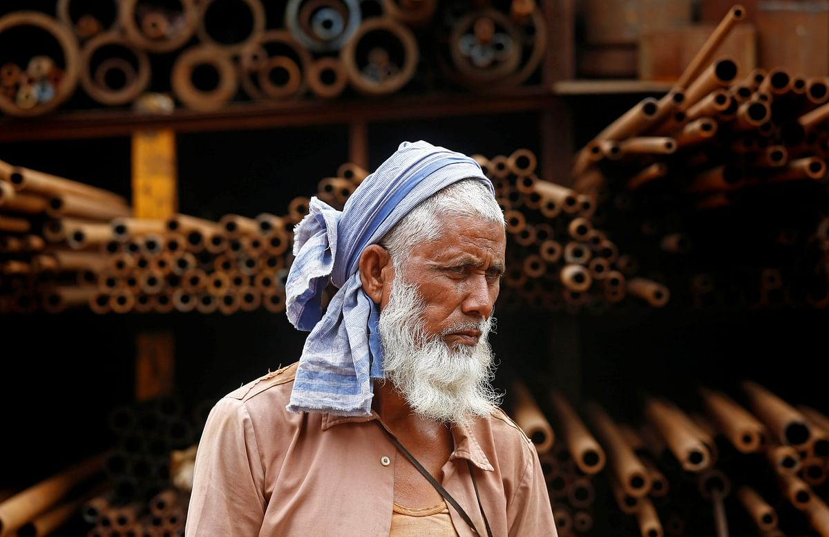 A labourer stands in front of a steel pipe storage rack. If India's growth rate climbs in 2022, then its capacity for consumption of commodities will match it. It needs to start investing in capscity augmentation or risk the option of imports.