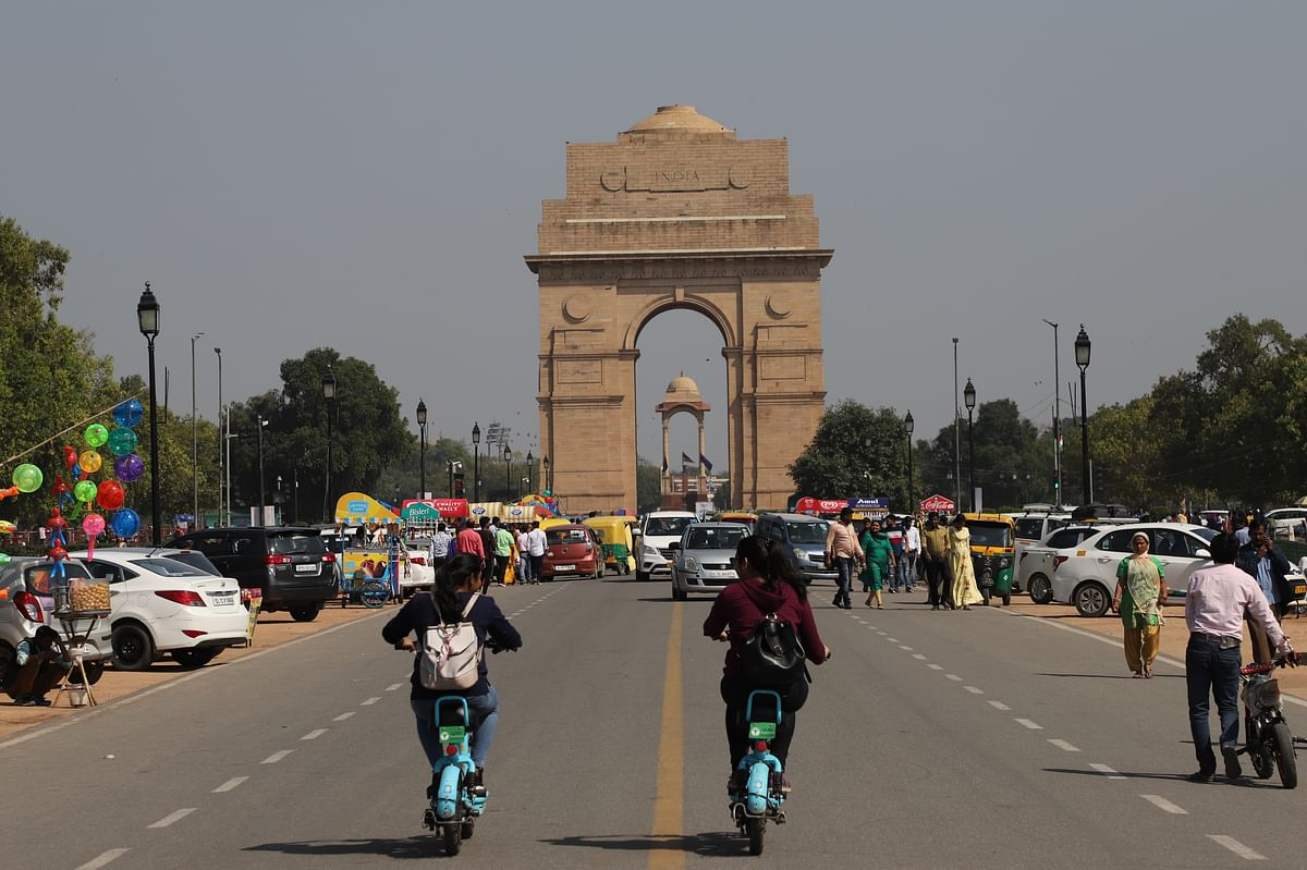 Girls ride e-scooters near India gate in New Delhi. Despite being self-sufficient in raw materials India will now look to reduce its imports on rechargeable batteries.