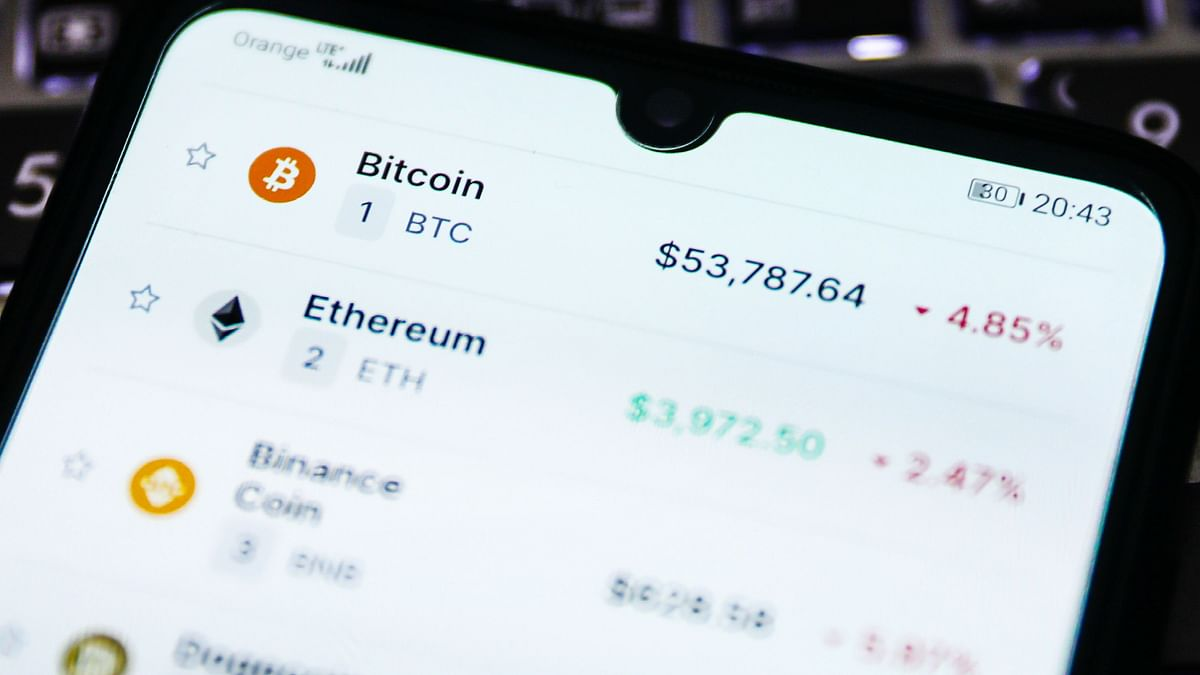 Cryptocurrency prices displayed on a mobile phone screen. The computers which maintain the Ethereum blockchain are incentivised with Ether while the developers who write these contracts have to pay for the privilege to deploy the code on the network in Ether.