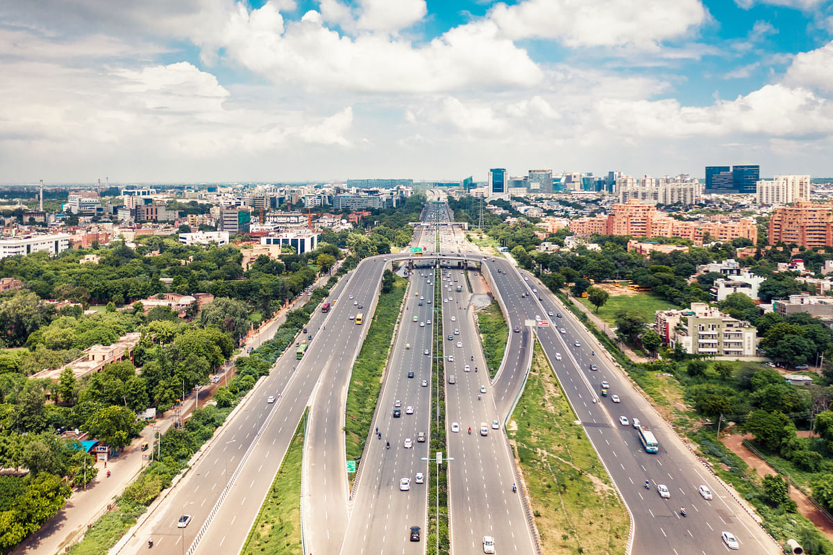 Highway NH48 in New Delhi India, with the cityscape of New Delhi. The DDA is preparing Master Plan for Delhi 2041, a vision document for the city's development over the next two decades.