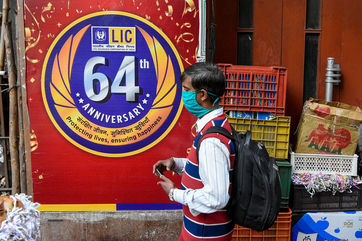 A man walks past an LIC billboard. Union finance minister Nirmala Sitharaman announced Life Insurance Corporation's (LIC) IPO to enter the share market in the oncoming fiscal year. She has also proposed to increase FDI in insurance sector from current 49 % to 74 %.