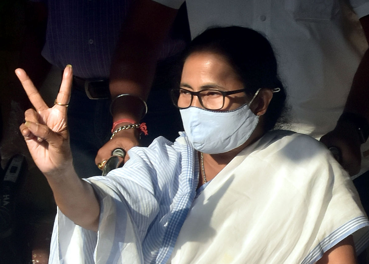 West Bengal's chief minister Mamata Banerjee flashes the victory sign after voting. Though she lost her seat in Nandigram the ruling TMC brought home an impressive result to retain power by a handsome margin.