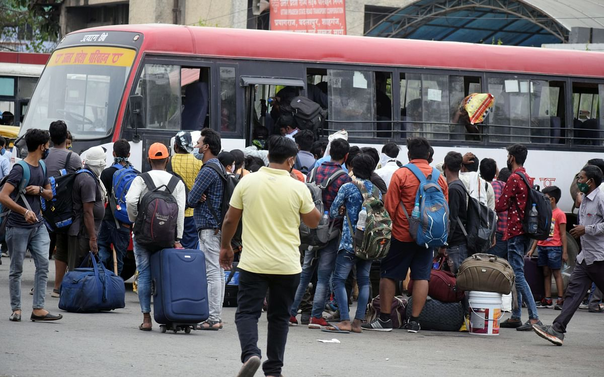 Migrant workers board a bus to reach their native places during lockdown amid a countrywide spike in coronavirus. The pandemic's second wave has been brought about due to a combination of the three basic preventative layers compounded by other problems.