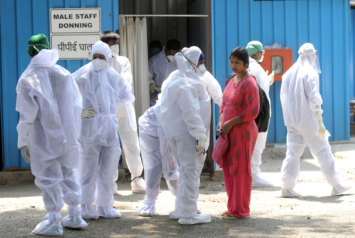 Healthcare workers prior to the start of their shifts in India. Banks can provide fresh loans to companies engaged in manufacturing, imports and supplies of vaccines, Covid-related medicines, medical devices and oxygen generators.