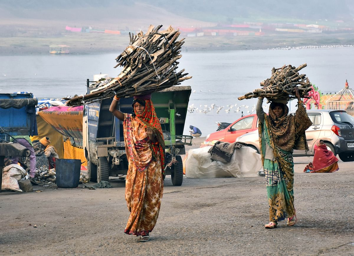 Rural women carrying wooden sticks on their heads. Clear readings are still not emerging from the country's rural areas where infections are spreading rapidly.