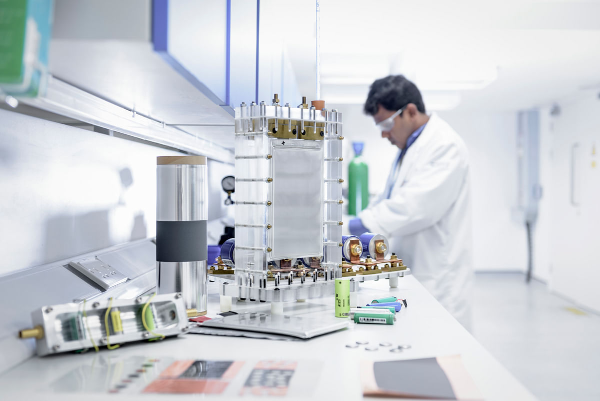 Scientist assembles lithium ion battery samples in battery research facility. India needs an estimated an annual battery capacity of 158 GWh by FY30, in order to meet its EV targets for 2030.