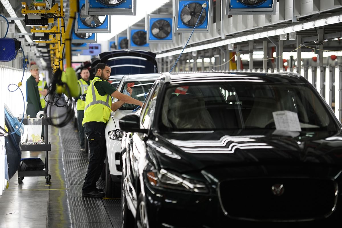 Vehicles being checked at the Jaguar Land Rover factory in Solihull, England. The UK wants tariffs removed of up to 150 per cent on whisky and 125 per cent on British-made cars.