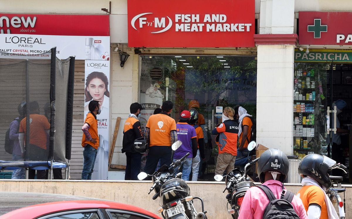 Swiggy delivery personnel colleting their orders. Emerging fintech players are offering almost all financial services under a single umbrella, right at the customer's doorstep.