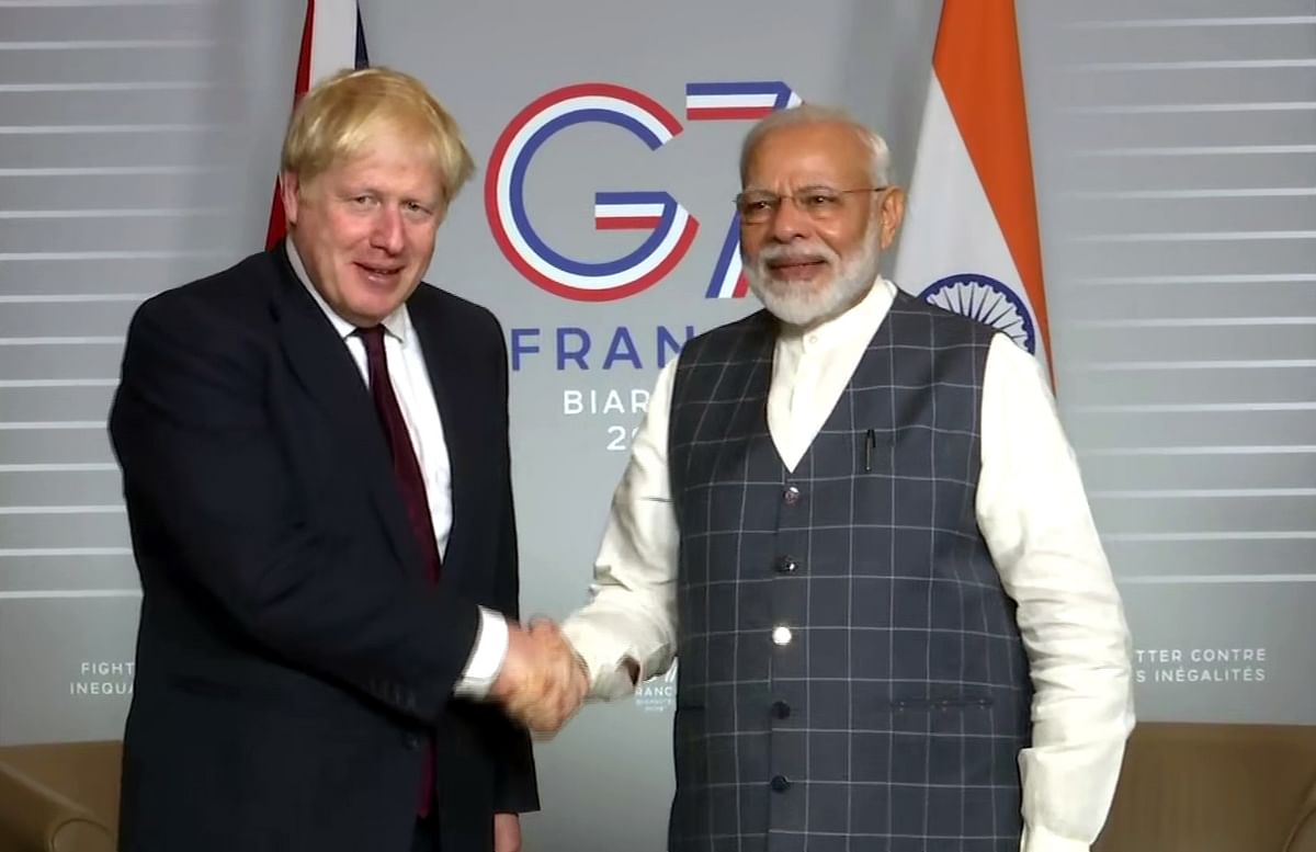 Indian PM Narendra Modi and his British counterpart Boris Johnson at the G7 meeting in 2019. Modi will put in a virtual appearance in June.