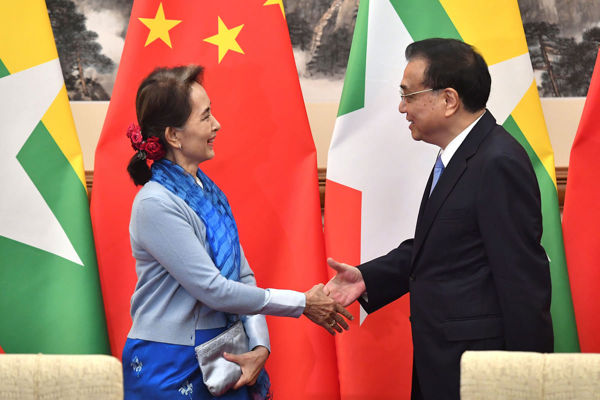 Former Myanmar state counsellor Aung San Suu Kyi with Chinese premier Li Keqiang. China is rumoured to be fanning the flames of unrest in Myanmar.
