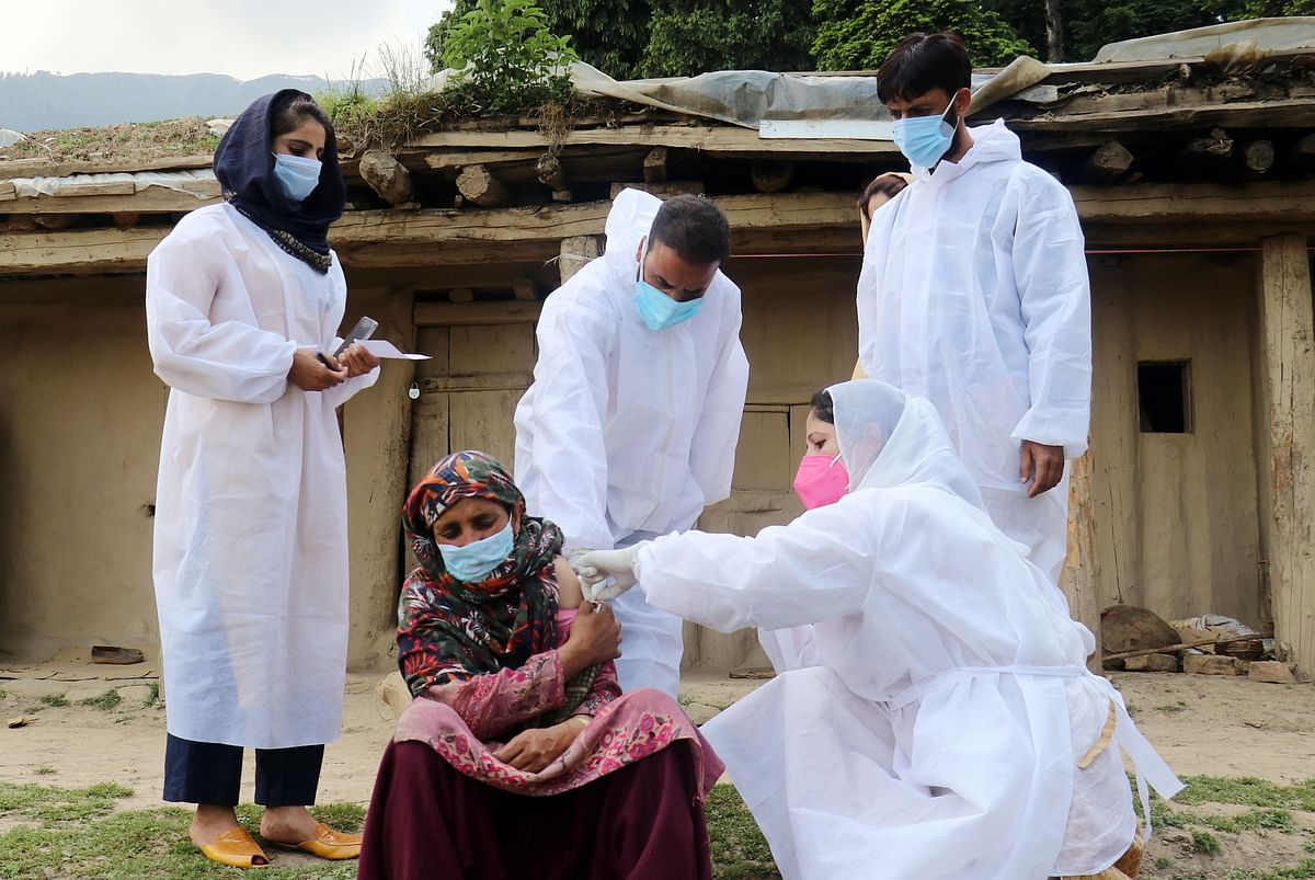 A Kashmiri Gujjar woman being treated by health workers. The Modi government has launched an accelerated drive to train 117,000 additional health workers, who will be pressed into service when their training ends.