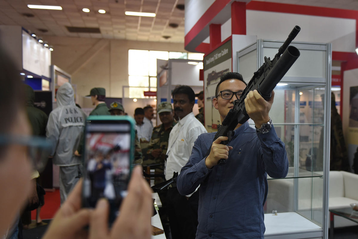 A visitor with guns made by India's Ordnance Factory Board. With the Goi focusing on Mande in India the the new structure will help in overcoming several shortcomings in the existing system and create opportunities in the global market.