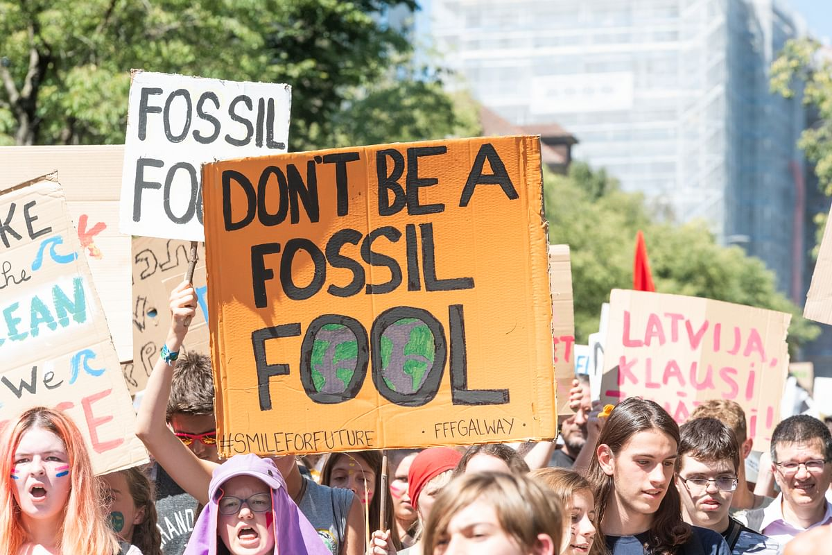 Students demonstrating for immediate action against climate change. The key to meeting climate goals is accelerated development of science and technology.
