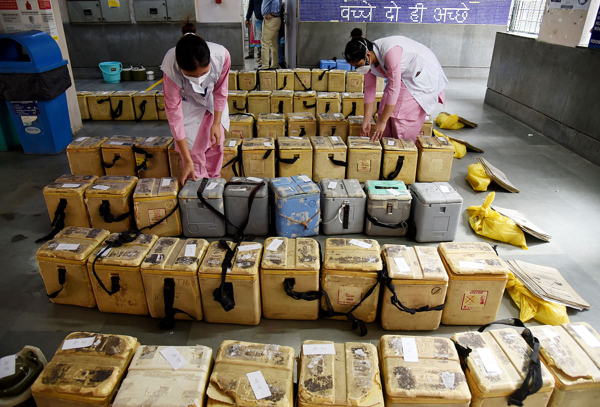 Health worker arranges polio vaccine drop boxes during 'Polio Ravivar' after post-covid. The Reserve Bank of India had announced an on-tap liquidity window for banks worth Rs500 billion to extend credit to health services and vaccine manufacturers until March 2022.