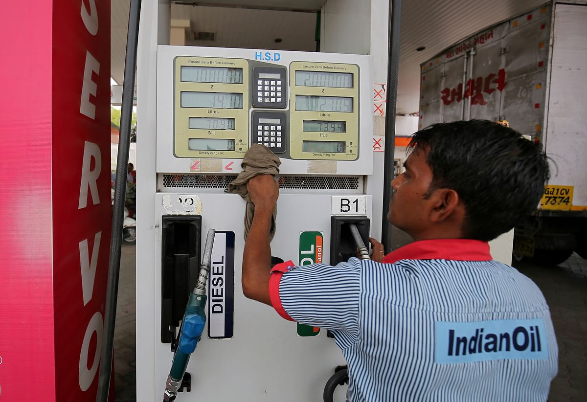 A fuel pump attendant cleans the keypad of a pump at an Indian Oil filling station. India had suffered a debilitating trade deficit with China for a number of years. In fiscal 2021, that figure came down to $44bn from $63bn.