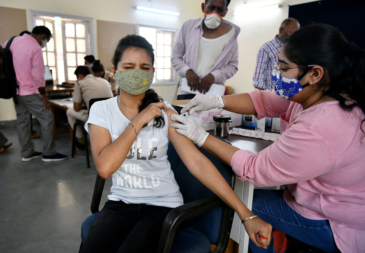 A healthcare worker inoculates a beneficiary with a dose of the COVID-19 vaccine. According to Jaishankar the world has to come together to scale up vaccine production.