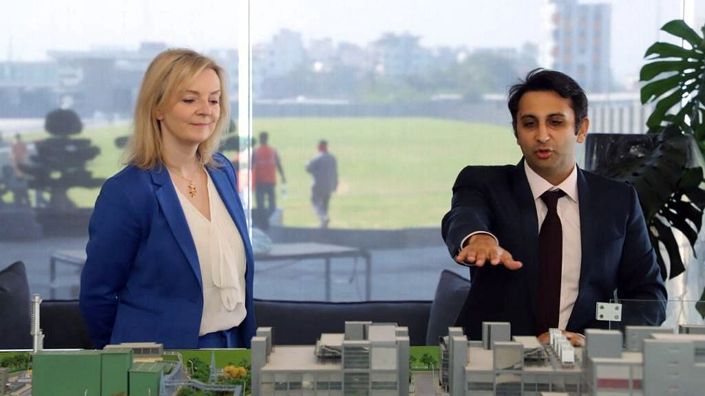 Poonawalla with UK's Secretary of State for International Trade Liz Truss during her visit to SII earlier this year. The SII is currently vaccinating four and five million beneficiaries a day in India, the highest in the world.