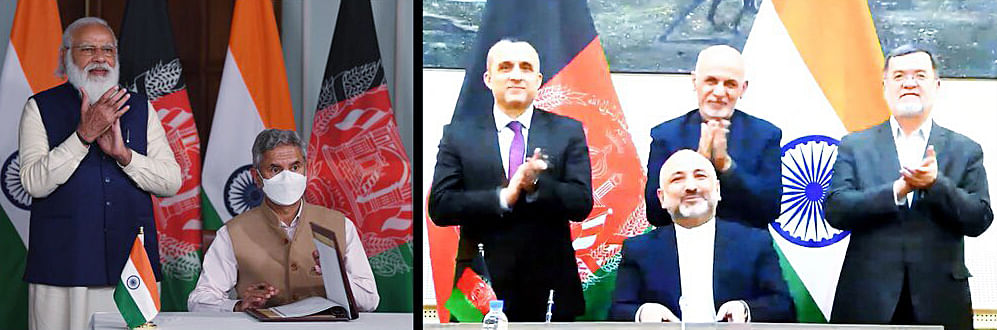 Prime Minister Narendra Modi along with External Affairs Minister Dr S Jaishankar during the signing of an MoU between India and Afghanistan, on the construction of Shahtoot dam near Kabul, through video conferencing with Afghanistan President Ashraf Ghani.