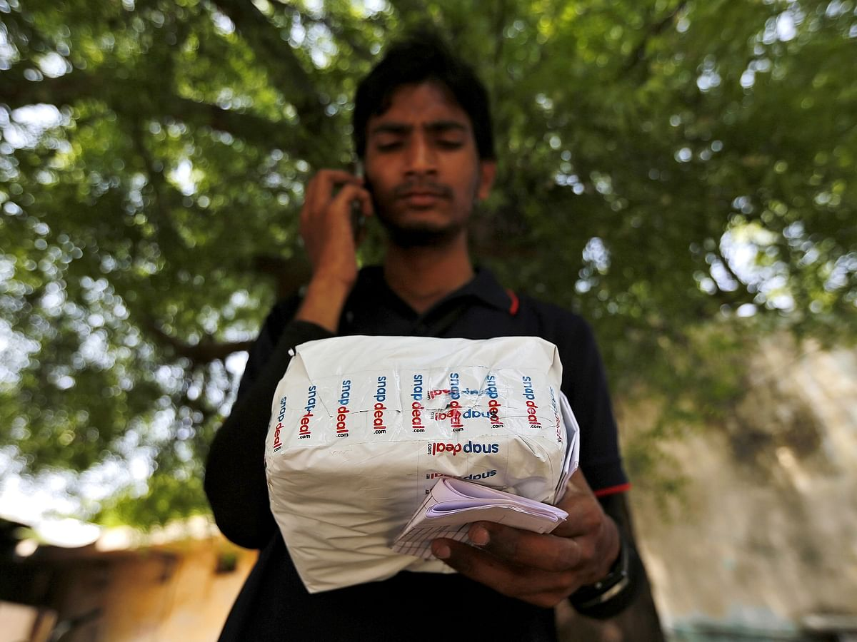 A worker of Indian e-commerce company Snapdeal.com makes a call to a customer before delivering a packet in Ahmedabad. People in Tier II and Tier III towns and beyond who jumped into the online shopping-learning-transacting bandwagon will give these platforms greater acceptability that will outlast the pandemic.
