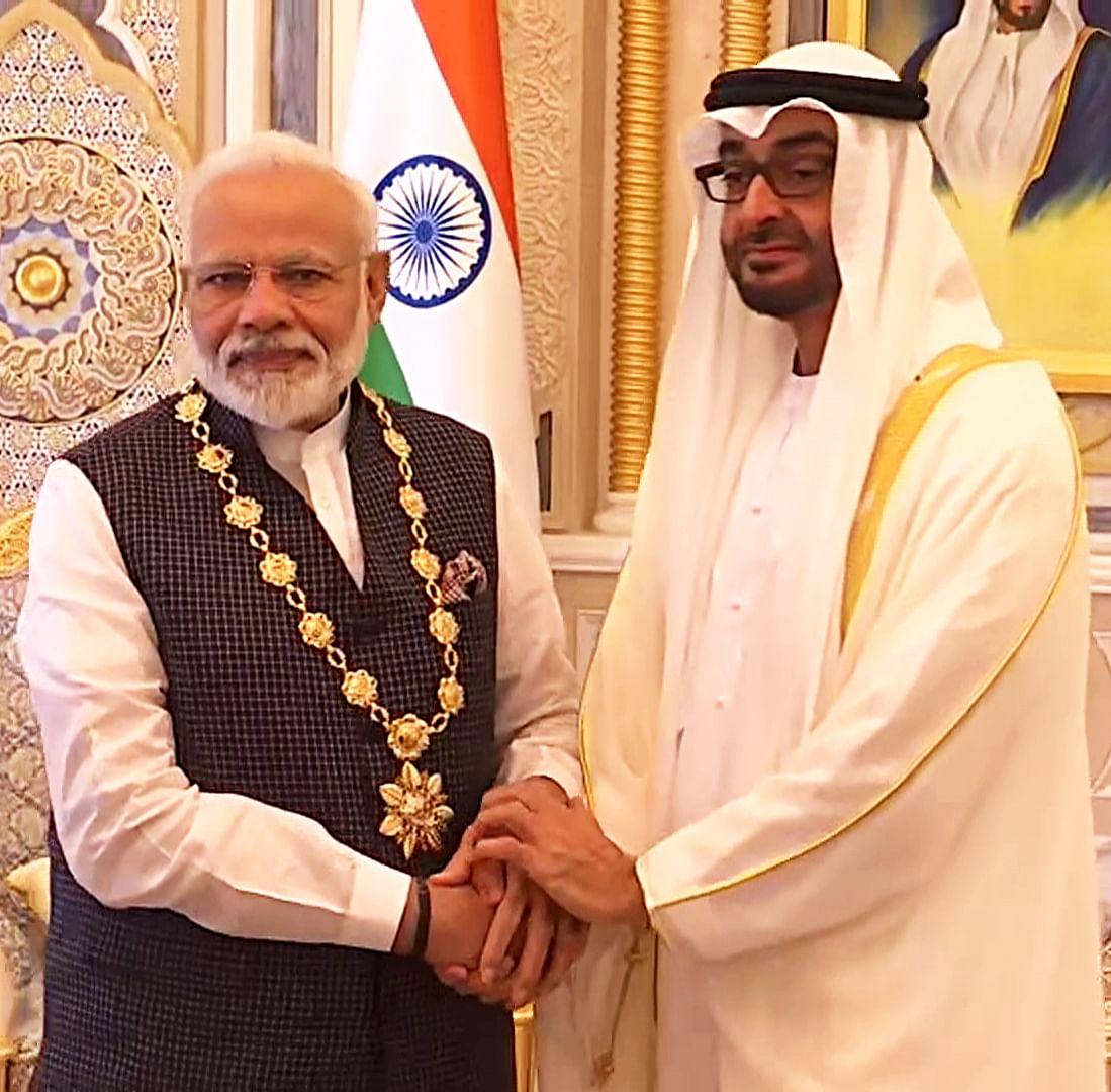 """Indian Prime Minister Narendra Modi with Abu Dhabi Crown Prince, Mohammed Bin Zayed Al Nahyan after being conferred with Order of Zayed, UAE's highest civilian award in Abu Dhabi in 2019. During the past six years, Modi has visited the UAE three times, while Sheikh Mohammed has visited India twice.  Bilateral relations were formally upgraded to a """"Comprehensive Strategic Partnership""""."""