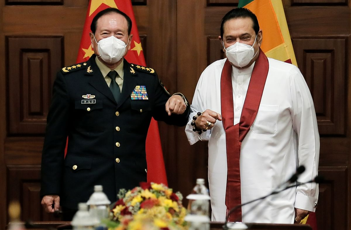 Sitting on the diplomatic fence. General Wei Fenghe, China's State Councilor and Defence Minister (L) with Sri Lanka's Prime Minister Mahinda Rajapaksa during an official visit in Colombo, Sri Lanka.