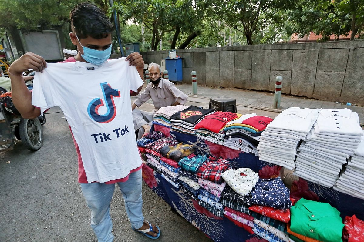 A customer tries a T-shirt with the logo of Chinese video-sharing app TikTok in New Delhi. The Indian government has banned more than 200 Chinese Big Tech companies from operating in India and the US has also followed suit.