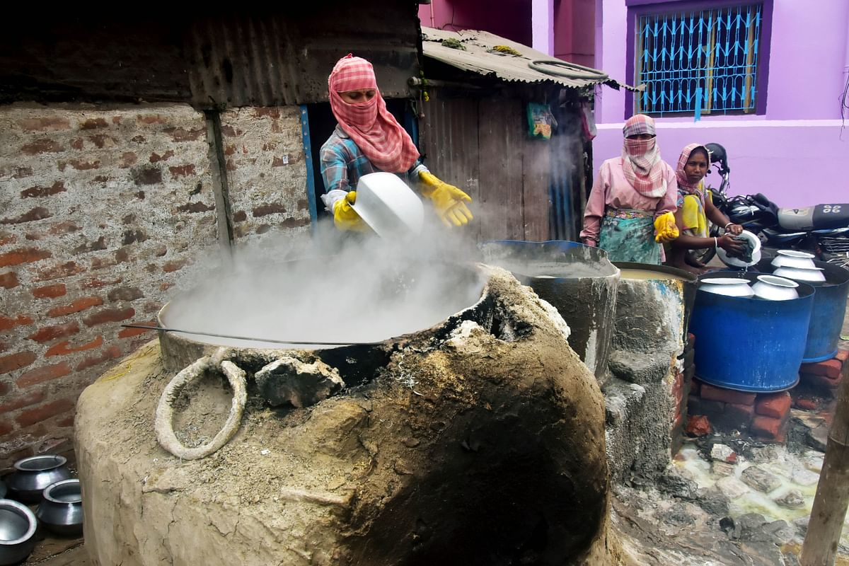Women laborers make aluminium-made cooking appliances in a village factory. Manufacturing activity rose in export powerhouses Japan and South Korea though firms suffered from supply chain disruptions and raw material shortages that pushed up costs.