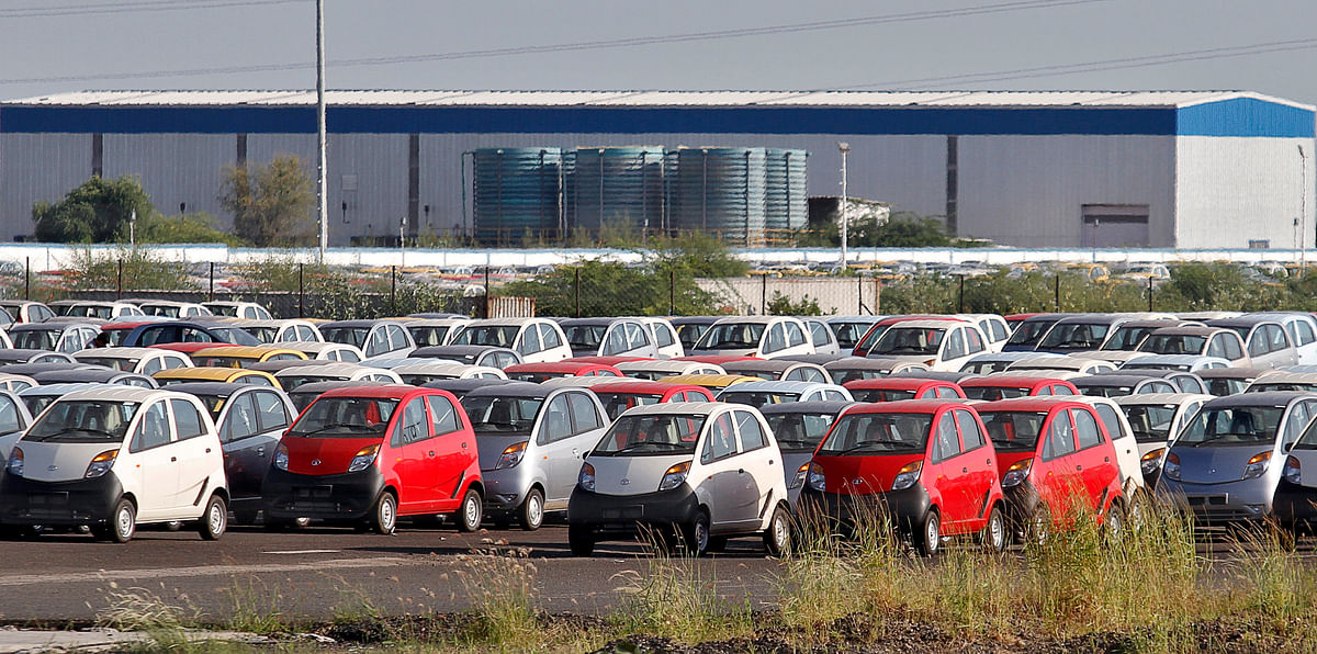 Tata Nano automobiles are seen parked at the carmaker's plant in Sanand, Gujarat. The government's proposed decision to slash inport duties in the auto industry could provide benefits to the domestic economy, specially with the entry of global players like Tesla.