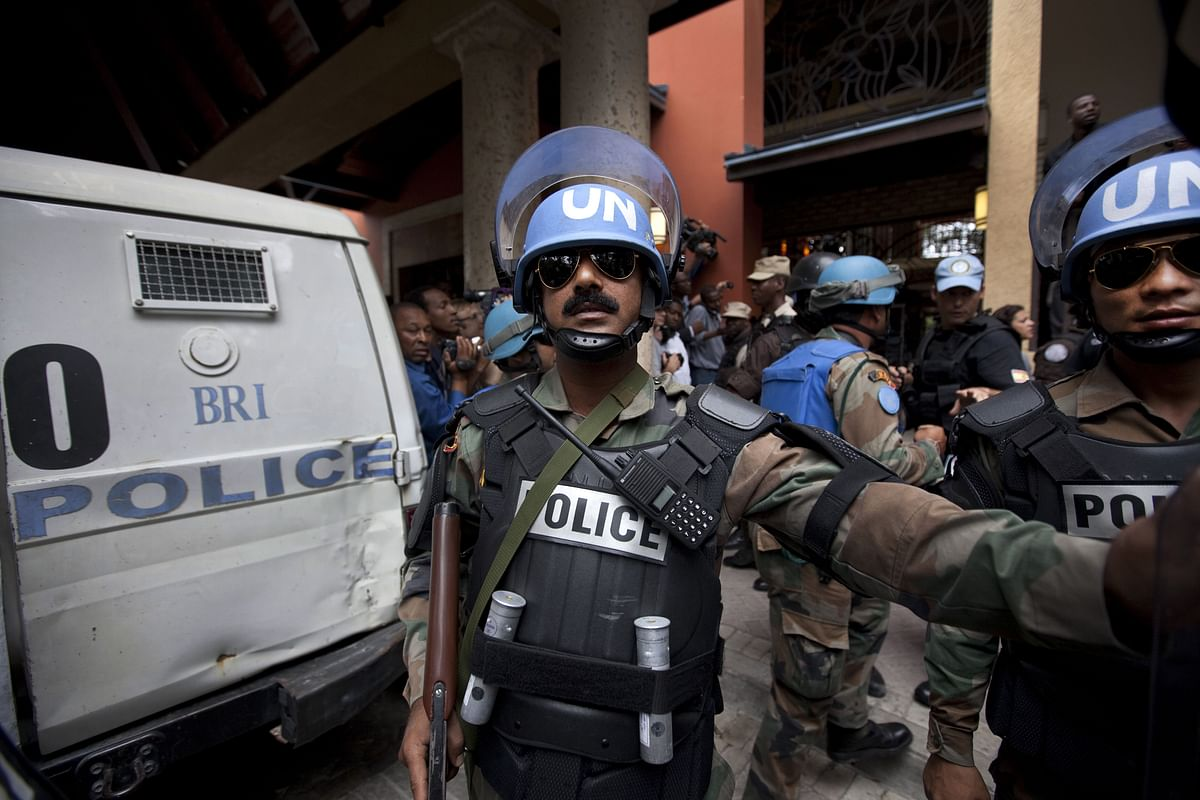 United Nations Peace Keeping Forces from India stand guard outside the Karibe hotel. India, the largest contributor to the UN Peacekeeping Force, has participated in 49 missions and committed a cumulative number of 250,000 personnel, including policemen.