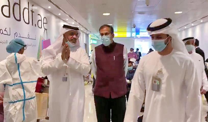 Indian Ambassador to the UAE, Pavan Kapoor examines the medical screening process for returning Indian nationals under Vande Bharat Mission during coronavirus lockdown, at Abu Dhabi airport.