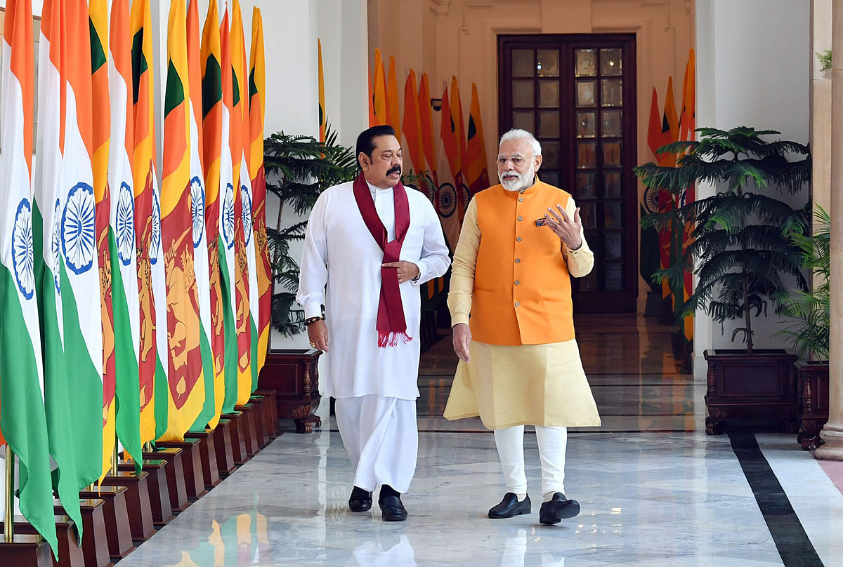 Indian Prime Minister Narendra Modi interacts with Mahinda Rajapaksa, The Narendra Modi government has been consistent in its outreach to Colombo. In evidence are the numerous projects bankrolled by India in contrast to a debt trap which is China's overall strategy.