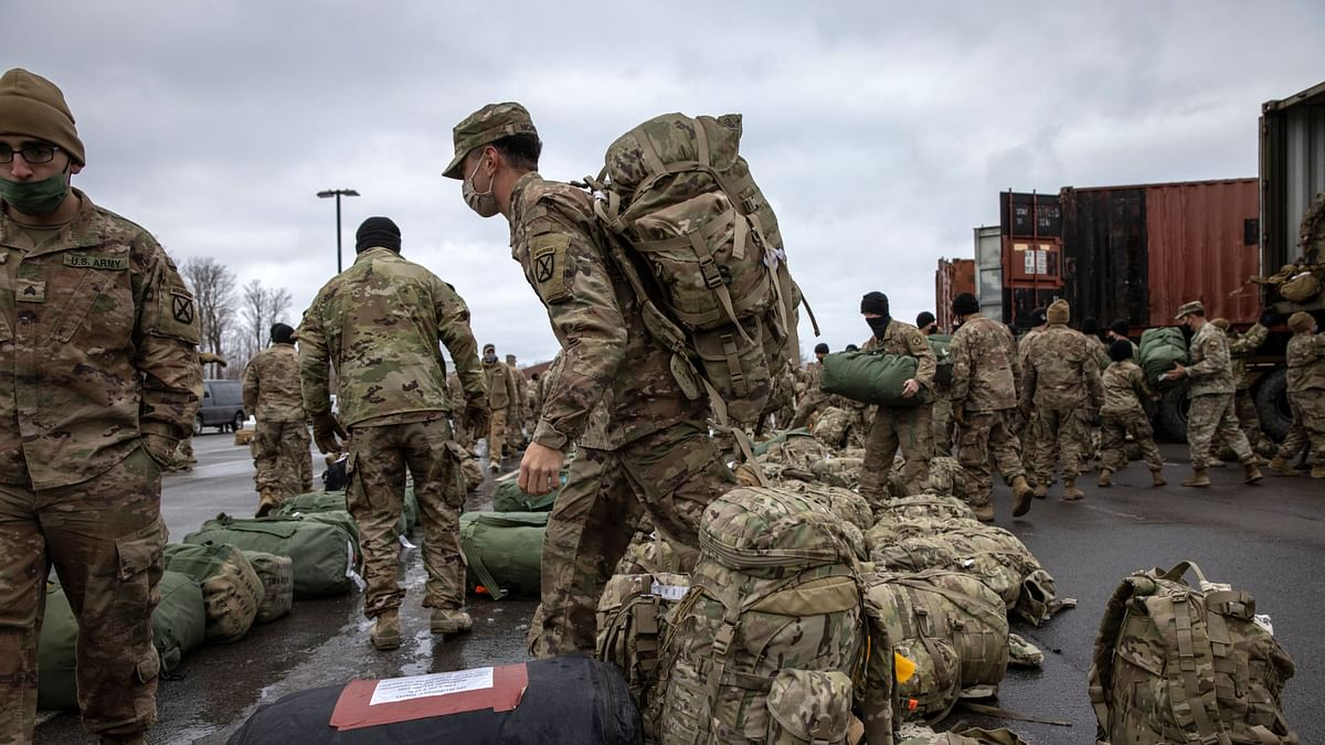U.S. Army soldiers retrieve their duffel bags after they returned home from a 9-month deployment to Afghanistan at Fort Drum. The West has been scrambling to come to grips with how best to handle the takeover by the Taliban since the withdrawal of US troops from the region.