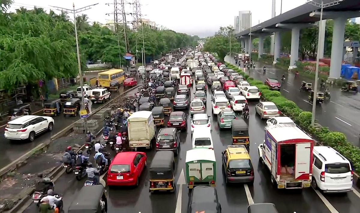 A heavy traffic jam at the Western Express Highway, in Mumbai. With its focus on rail, road and ports India is moving ahead to break silos within the transport network and improve travel time and productivity for industries and investors.