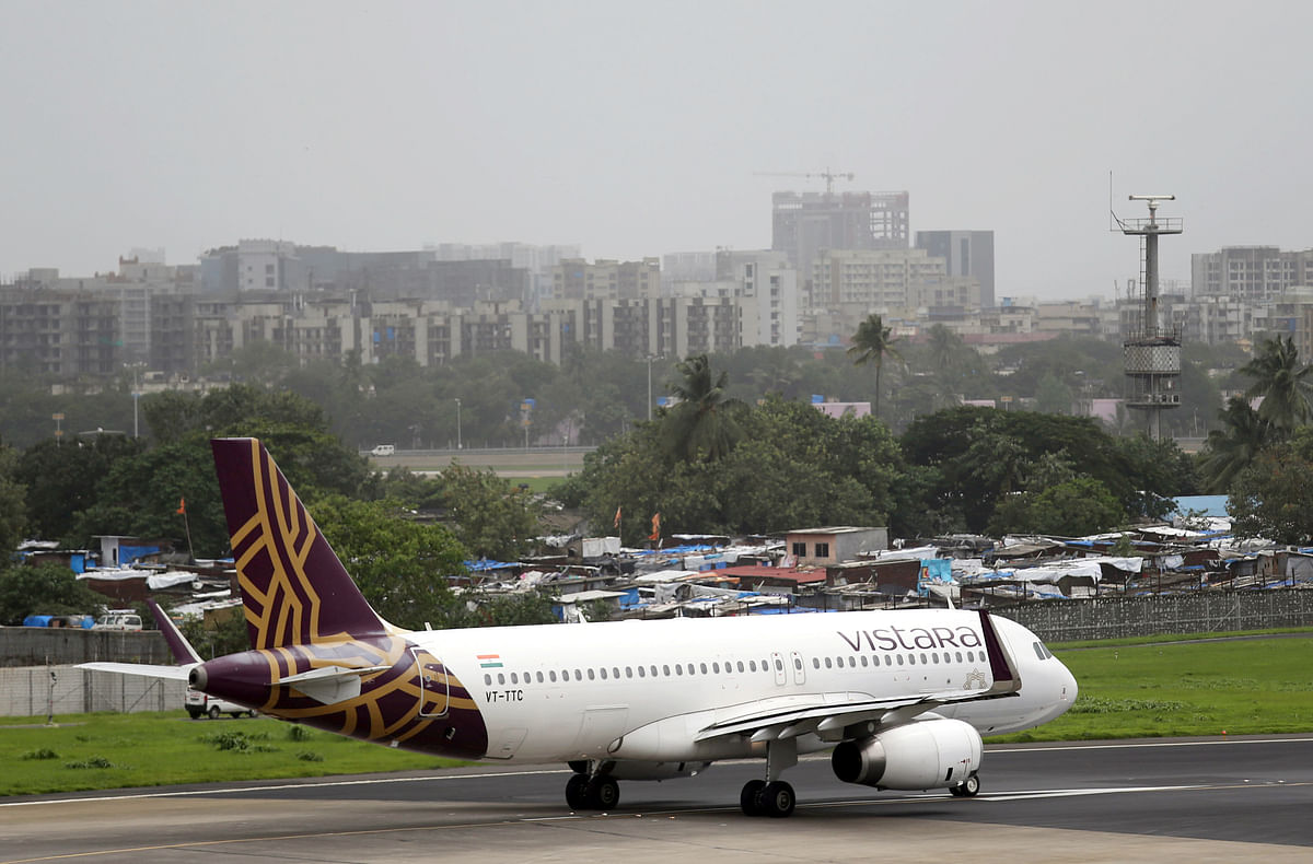 A Vistara Airbus A320 passenger aircraft prepares for takeoff at Chhatrapati Shivaji International airport in Mumbai. If the possibility of a merger between Air India and Singapore Airlines becomes a reality it could alter the dominance of established airlines to a great extent.