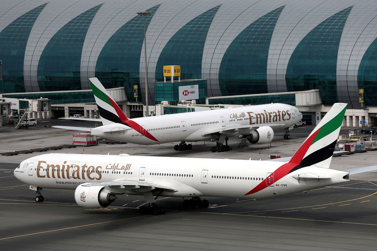 Emirates Airline Boeing 777-300ER planes are seen at Dubai International Airport in Dubai. GCC airlines had taken a big chunk of the business forfeited by Air India and they did so by exploiting the travel needs of the Indian customers and catering to their requirements.