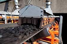 Copyright: Martin Engineering  A properly configured conveyor minimizes emissions for improved safety and easier maintenance.