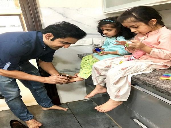 Gambhir shares picture with daughters, says 'gradually mastering pedicure skills'
