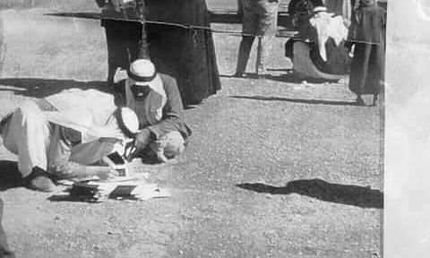 Rare: 1950 Saudi immigration officers verifying passport details seated on the ground