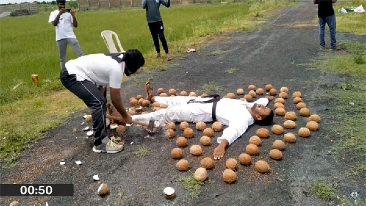 World record: Blindfolded martial artist smashes 49 coconuts in 1 min near student