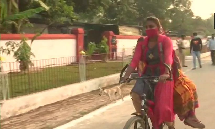 Girl arrives with grandmother on cycle to cast vote in Bihar polls