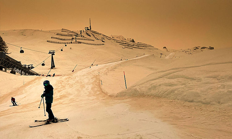 Sahara desert sand gives snow an orange hue in Swiss alpine resort