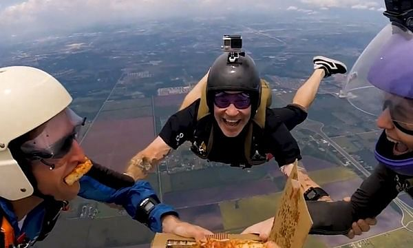 The Pie High: Skydivers gorge into pizza while freefalling from 14,000 feet