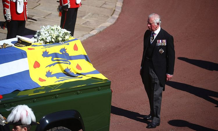 Prince Charles follows the coffin of his father Prince Philip.