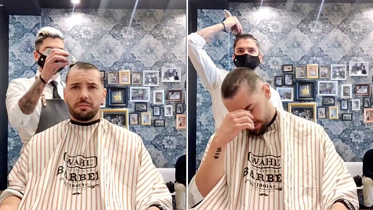 Barber moves cancer patient to tears as he shaves off own hair in incredible gesture