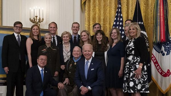 White House retreats to normalcy: Biden takes off masks, officials 'hug around'
