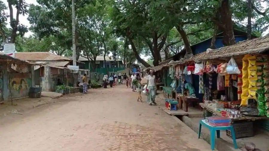 Bangladesh locks down Rohingya camps after virus spike
