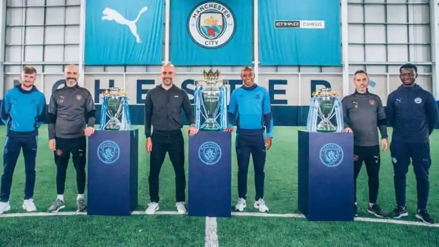 Football: Manchester City win hat-trick of Premier League titles