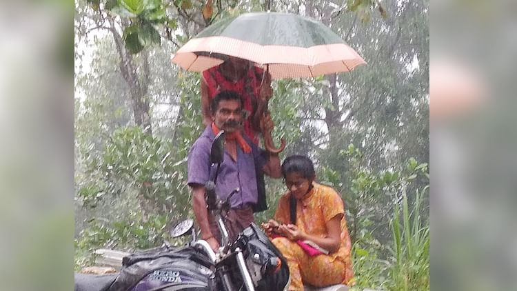 Photo of man shielding studying daughter with umbrella goes viral on Father's Day