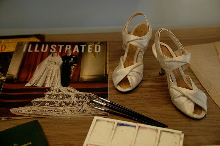 Prototype shoes for the ones Britain's Queen Elizabeth II wore at her wedding are displayed.
